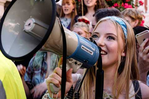 Student using megaphone at climate change protest in York