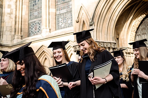 Graduates walking out of the Minster