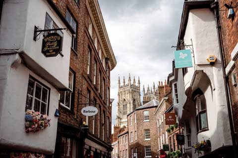 Looking down historic street in York city centre with Minster in background