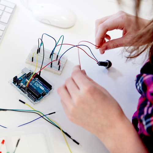 Student working with electronics