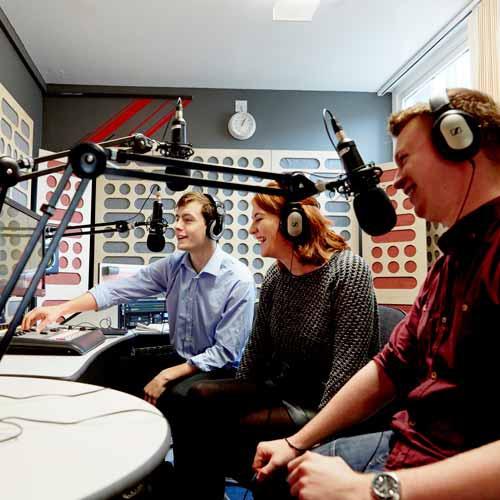 Students in radio recording studio