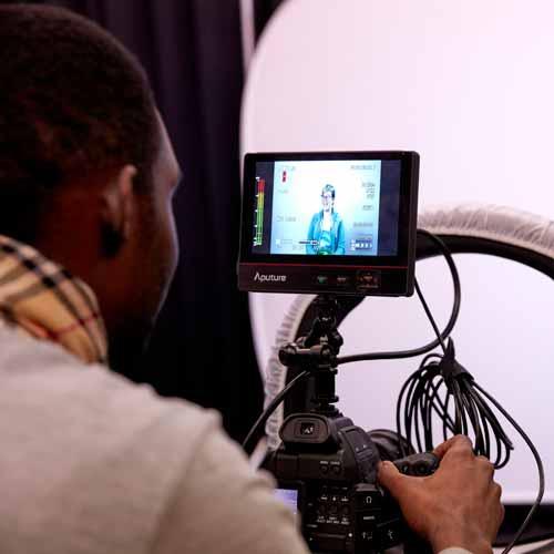 Student using filming equipment in studio