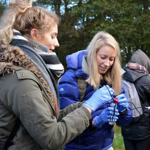Students setting up equipment on geography field trip