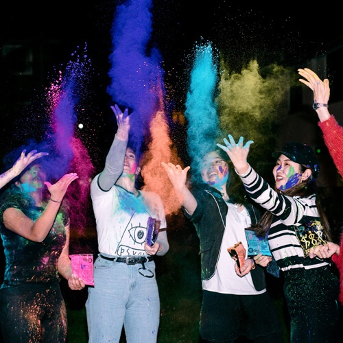 Students throwing colours for Holi