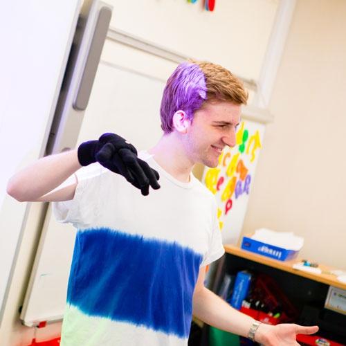 Student teacher using hand puppet