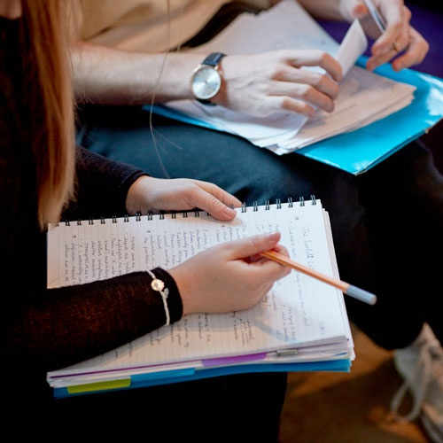 Two students studying and taking notes