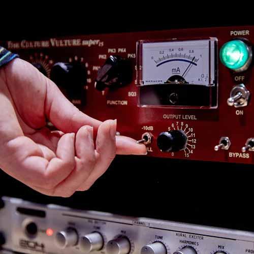 Close up of hand adjusting sound levels