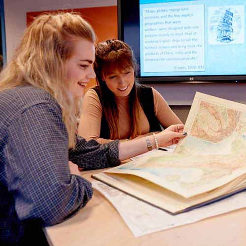 Geography students looking at map