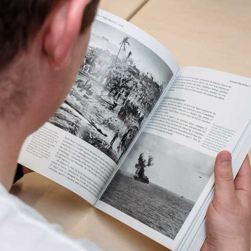 Student reading book about war