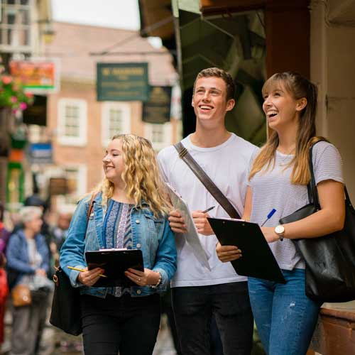 Students with clipboards in York
