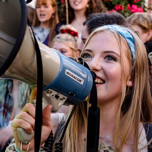 Student using megaphone at climate change protest