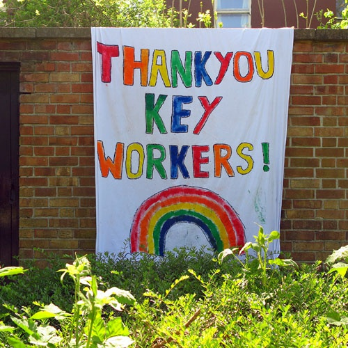 Painted sign on wall saying thank you key workers with a rainbow
