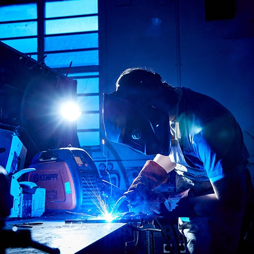Atmospheric image of a welder at work