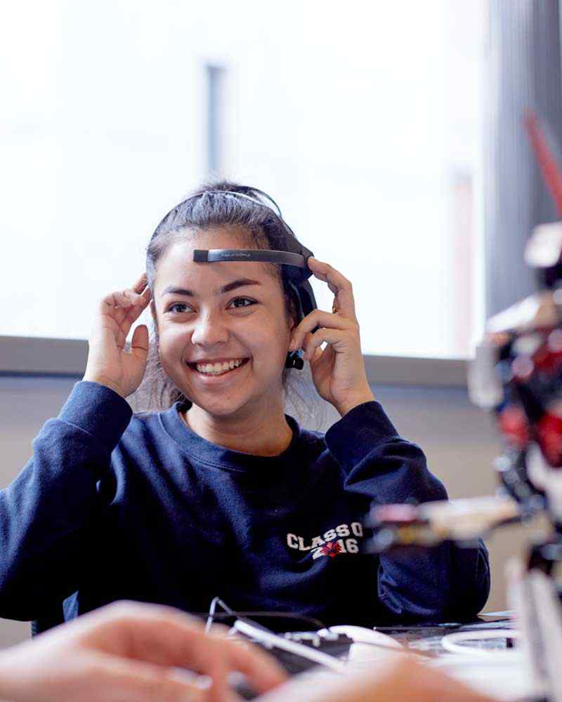 Student wearing headset in computer science class