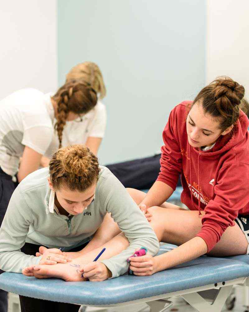 Students practising skills in physiotherapy lab