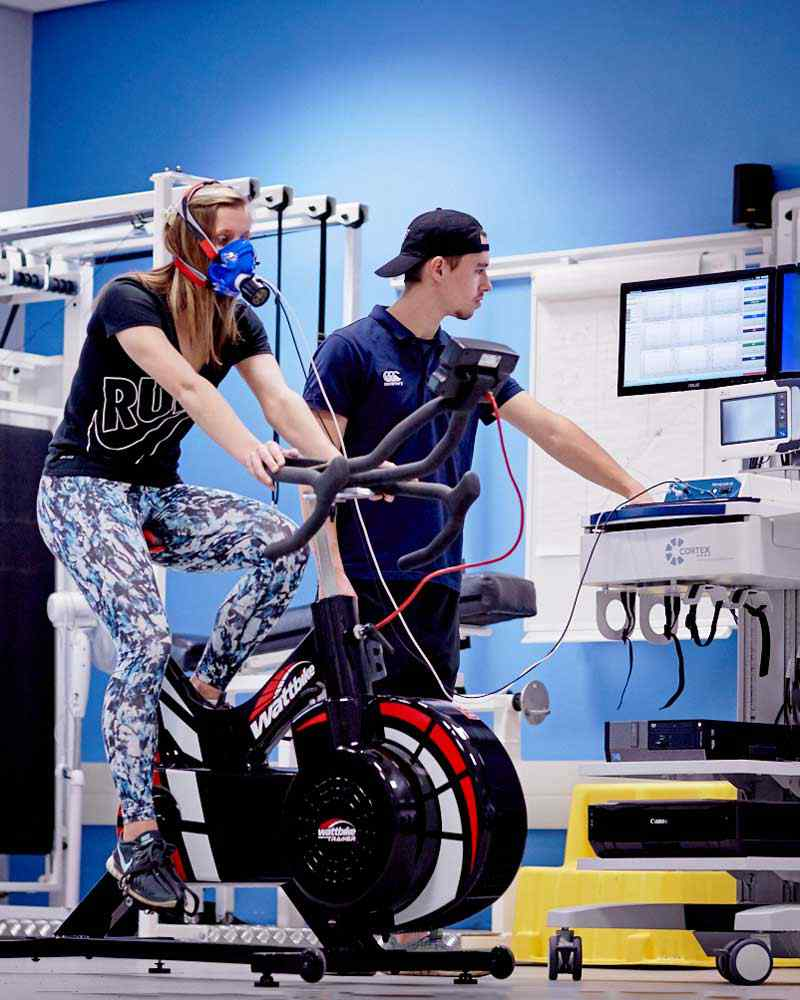 Student on exercise bike being monitored on screen